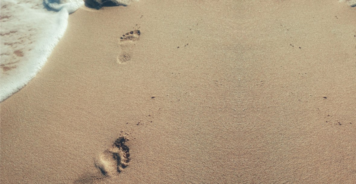 Footsteps on a beach - take first steps in Facebook ads
